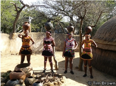 Zulu woman at Shakaland demonstrate how to carry pots on their heads