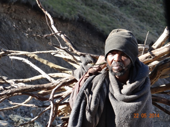 The man that collects wood daily in Lesotho on our Sani Pass Day Tour from Durban 22 May 2014