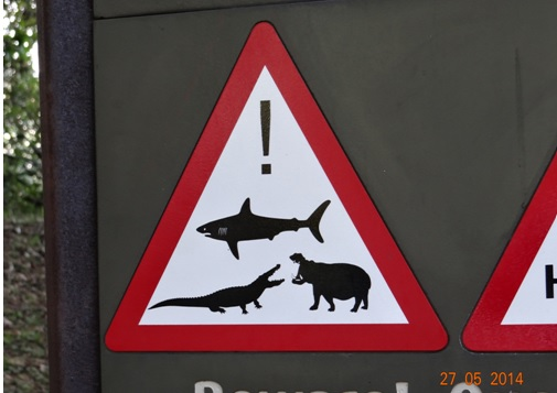 Warninng signs in St Lucia on our 5 Day Hluhluwe Umfolozi Big 5 Safari Tour including St Lucia and Durban