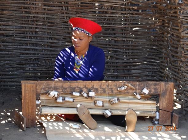 Married Zulu women makes a grass mat