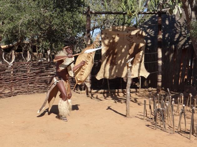 Zulu man demostrates Zulu warfare on our Durban Cultural Tour