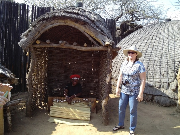 Durban Day Tour to Shakaland. The Chiefs 1st wife weaves a grass mat for sleeping