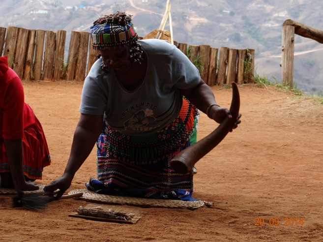 Sangoma throws the bones on our Durban Safari near Durban to Tala game reserve, Valley of 1000 Hills and Zulu Cultural Village