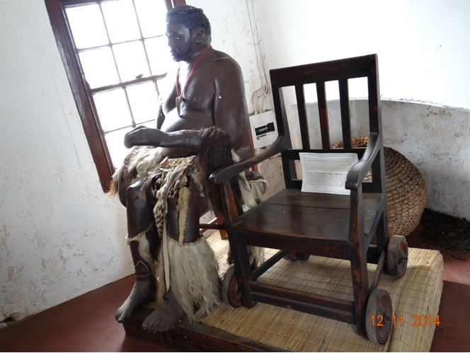 Model of King Mpande and his original wheel chair built by the Norweegion Missionarys seen on our 5 Day Durban Safari Tour
