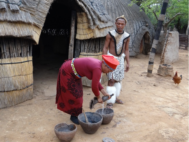 Zulu lady demostrates how to make umqomboti or Traditional Zulu beer on our Durban Tour