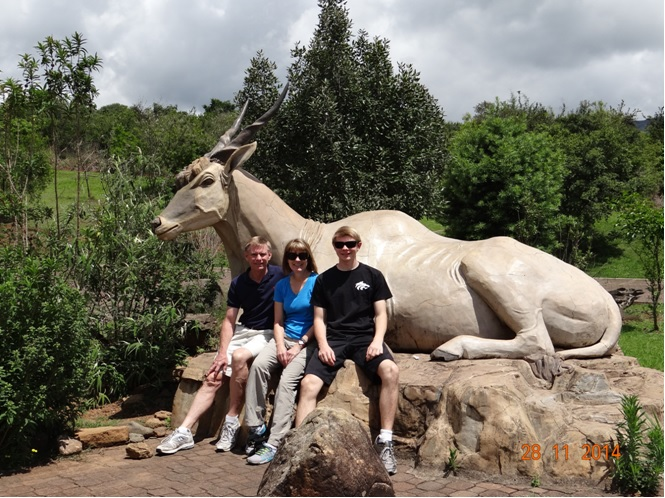 My clients and a statue of an Eland antilope at Didima during our Drakensberg Tour
