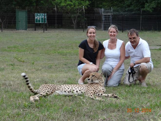 My clients with a cheetah on our Durban safari tour