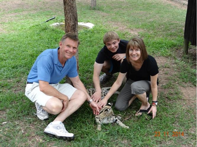 My guests with a Serval during our 3 Day Safari tour
