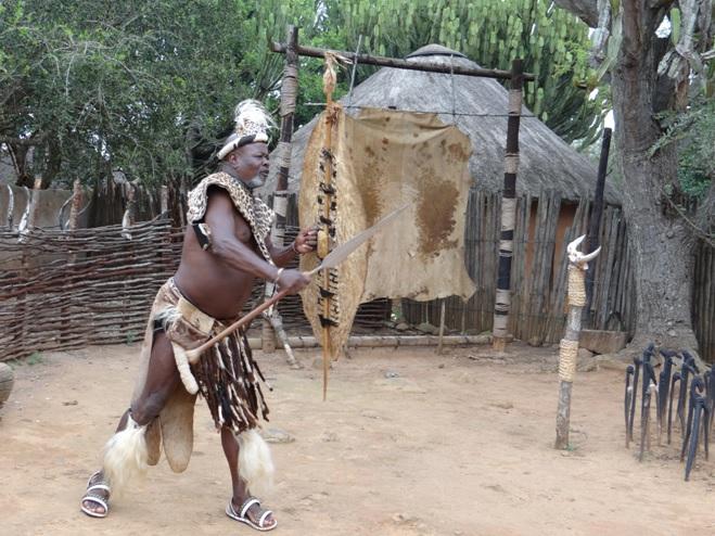 Zulu man demonstrates how the Zulus killed the British