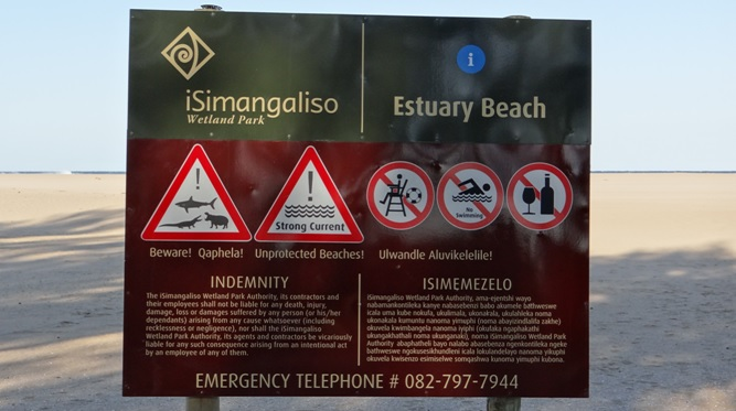 Durban day tour; Warning sign on St Lucia estuary beach