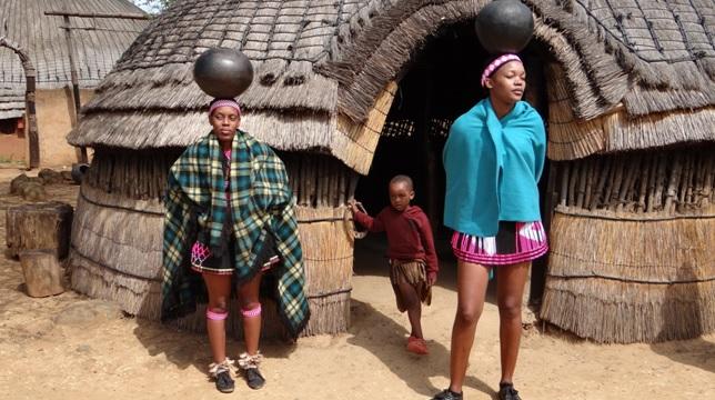 Shakaland tour; Zulus carry pots on head