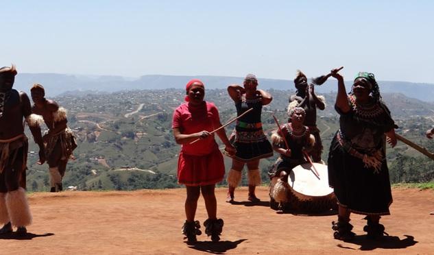 Zulu culture tour; Zulu Sangoma dancing with Wildebeest tail