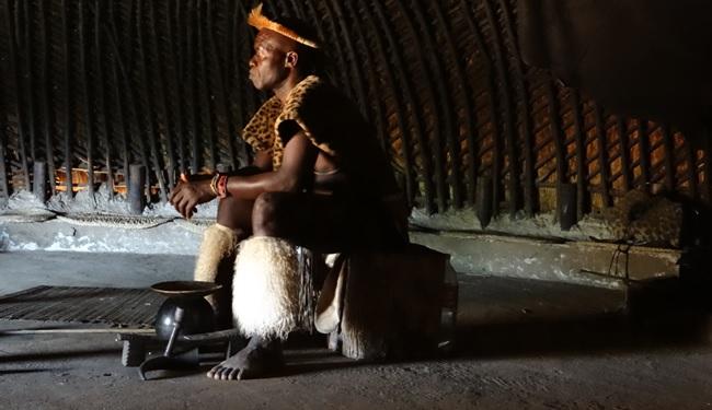 Zulu culture tour; Zulu chief in traditional Zulu hut