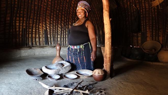 Zulu culture tour; Zulu lady in traditional zulu hut